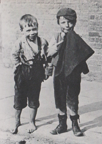 monochrome photograph two street children 1890 London